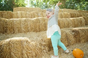 Little Olivia is excited about the hay!